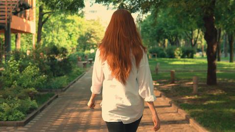 rear redheaded girl enjoy freedom have fun outdoors Footage