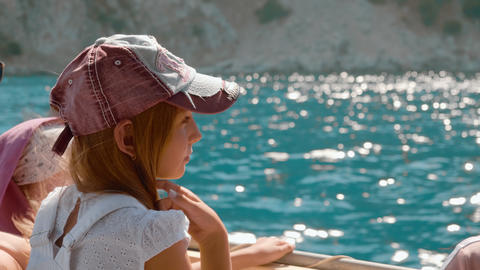 Tourist girl traveling on sailing boat at sea cruise. Teenager girl sitting Live Action