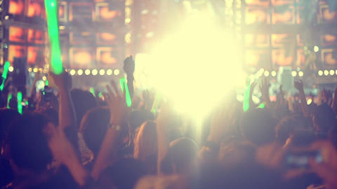 People at concert and light flares slow motion Footage