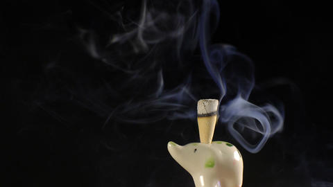 Smoke incense cone in ceramic statuette of elephant loop Footage