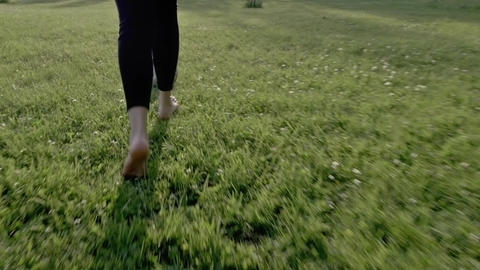Young Woman Playing Soccer Football on Summer Grass Slow Motion - Natural Look Footage