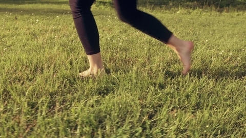 Happy Young Woman Jumping and Dancing on Grass Slow Motion - Graded Look Footage