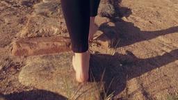 Young Woman Walking on Rocks on Beach Slow Motion - Warm Graded Look Footage