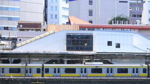 Commuter train arriving at the station/東京にある駅。 Footage