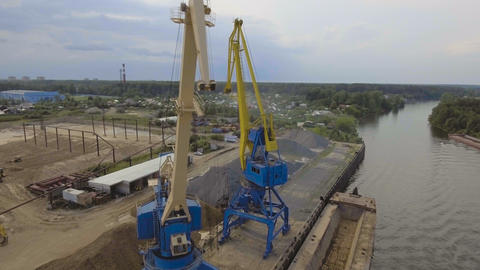 Aerial view:River port with cranes and ships Footage