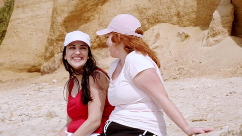 A carefree relaxing day at the beach - beautiful girls on summer holiday Footage