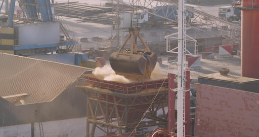 Grapple crane loading. Commerce, nautical. Delivery of agriculture cargo by Live Action