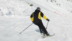 Young adult recreational skier enjoys idyllic perfect weather in cold winter Live Action