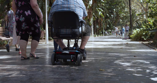 Barcelona, Spain - October 15, 2019: Motorized mobility scooter for elderly and Live Action