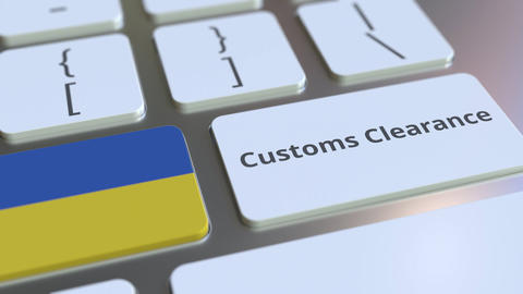 CUSTOMS CLEARANCE text and flag of Ukraine on the computer keyboard. Import or Live Action