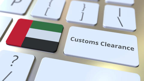 CUSTOMS CLEARANCE text and flag of the United Arab Emirates UAE on the computer Live Action