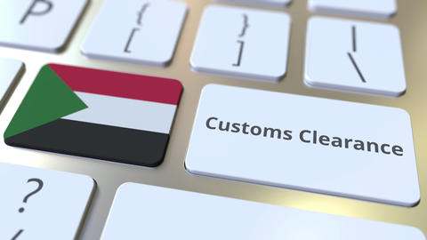 CUSTOMS CLEARANCE text and flag of Sudan on the computer keyboard. Import or Live Action