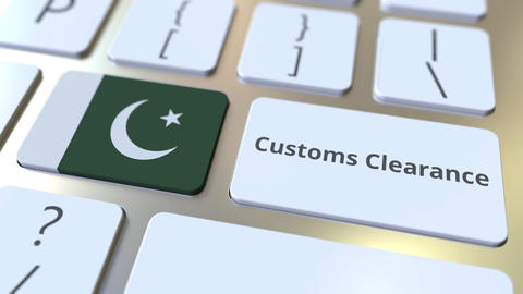 CUSTOMS CLEARANCE text and flag of Pakistan on the computer keyboard. Import or Live Action