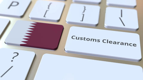 CUSTOMS CLEARANCE text and flag of Qatar on the computer keyboard. Import or Live Action