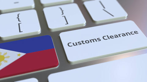 CUSTOMS CLEARANCE text and flag of Philippines on the computer keyboard. Import Live Action