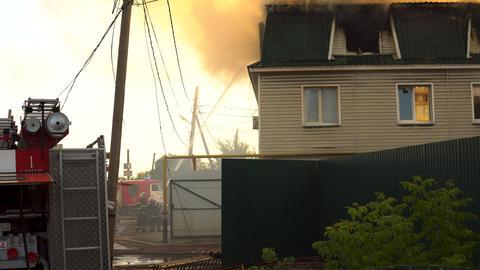 Samara, Russia - July 30, 2019: Russian firefighters extinguish a fire a three Footage