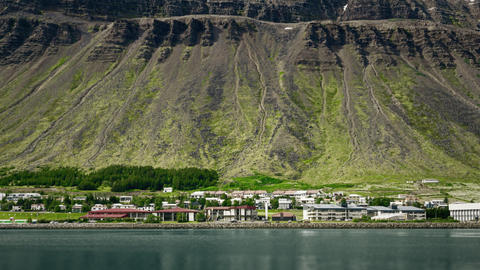 Houses At The Bottom Of A Rocky Mountain. Scenic Landscape In Iceland Live Action