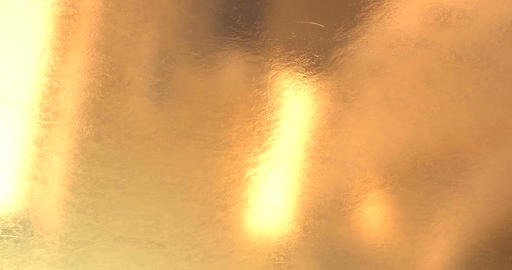 abstract motion gold sparkle waves like material flowing, golden metallic Live Action