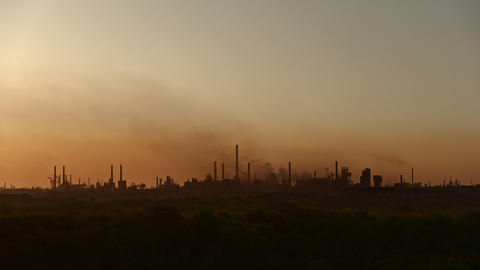 Silhouette of a large industrial plant polluting environment with emissions Footage
