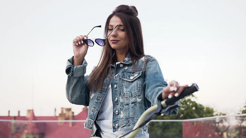 Portrait of attractive urban girl in sunglasses with beautiful hair looking at Footage