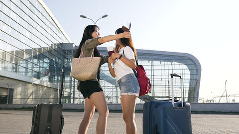 Slow motion of attractive high-spirited asian women rejoicing their joint trip Footage