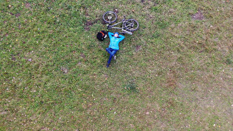 Woman bicycle rider relaxing having rest on green lawn,... Stock Video Footage