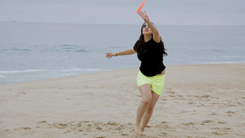 Young woman relaxes on the beach during her summer vacation Footage