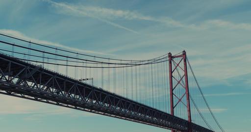 Aerial view. Under the bridge. Suspension bridge over Tagus river in Lisbon Live Action