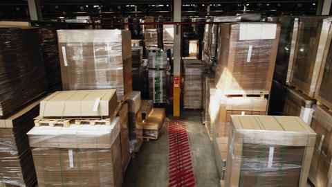cardboard paper and forklift among products in warehouse Live Action