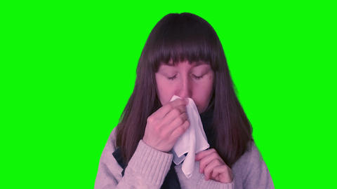 Young caucasian girl caught cold on green screen Live Action