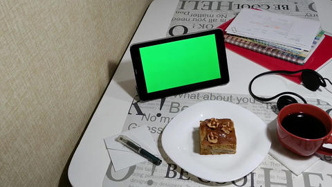 tablet with green screen in cafe Live Action