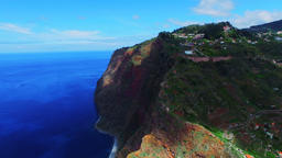 Flight aerial ocean mountain Funchal coast rocky cliff Portugal Madeira 4k video Footage