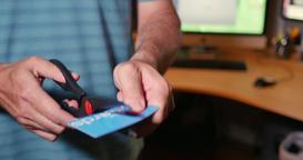 Closeup of a Man Cutting Up His Credit Card Footage