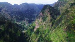 Portugal Madeira 4k aerial video. Mountain ravine village, houses, hills Footage