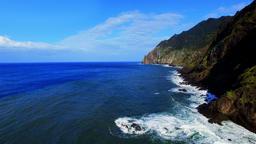 Flight over ocean sea surface. Portugal Madeira coastline 4k video. Surf coast Footage