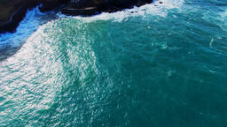 Portugal Madeira coast 4k aerial video. Sea ocean surface rocky shore water surf Footage