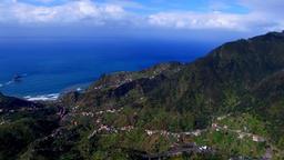 Aerial ocean sea rocky coast. Portugal Madeira village city 4k video Footage