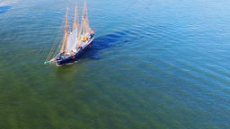 Sailing retro pirates historic ship ocean sea. Aerial flight HD sepia video Footage