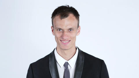 Portrait of young happy smiling business man, white background Footage