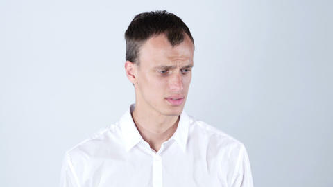 Closeup portrait of confused clueless young man Footage