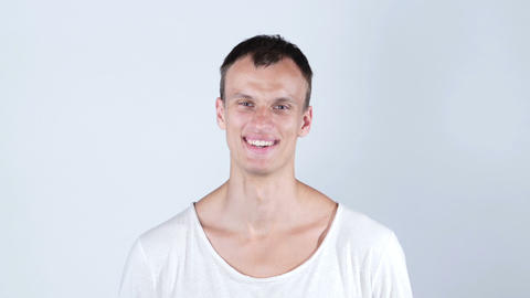 Young happy man laughing at camera , smiling portrait Footage