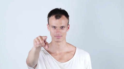 Portrait of a young man pointing his finger at you Footage