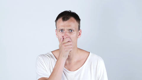 Shocked amazed dazed young man in white t shirt , white background Footage