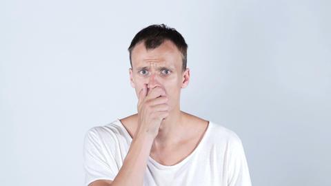 Shocked amazed dazed young man in white t shirt , white background Footage