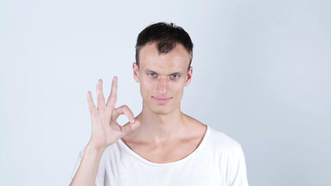 Portrait of a good looking young man with ok hand sign Footage