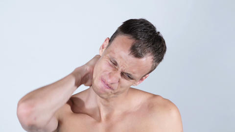 Studio shot of sportsman with pain in neck Footage