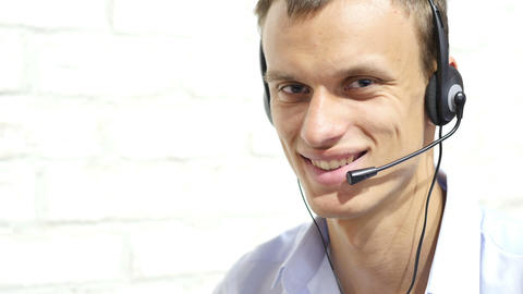 Smiling male customer support operator with headset Footage