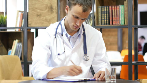 doctor writing a prescription, Medical Report of Patient in Clinic Footage