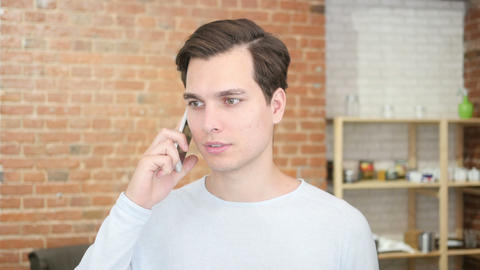 happy successful young man talking on cell phone Footage