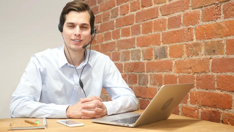 Smiling assistant using a headset in a call center , online customer service Footage
